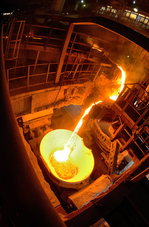 smelting plant: Hot steel pouring in ladle car train in steel plant