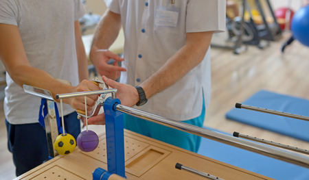 Hand therapy with physiotherapist Equipments Archivio Fotografico