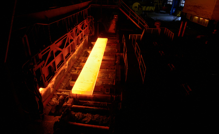 ferrous foundry: Sheet of hot metal on the conveyor belt from oven