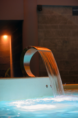 thermal spring: Relaxation pool in spa with waterfall
