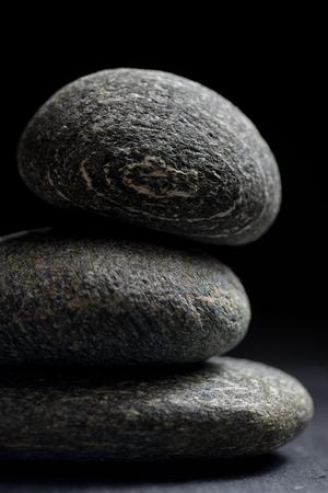 black stones: Pile of stones isolated on black background