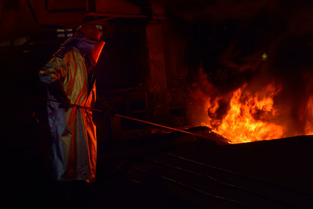 smelter: Steel worker inside of steel plant