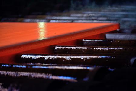 Hot steel plate on conveyor Stock Photo