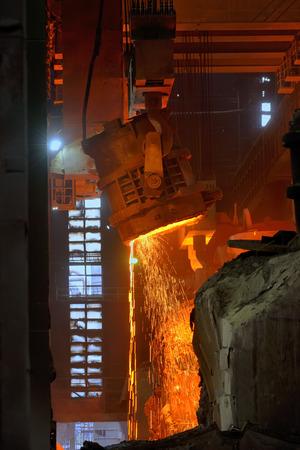 crucible: steel mills converter filling hot materials Stock Photo