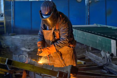 safety googles: Welder welding metal in plant Stock Photo