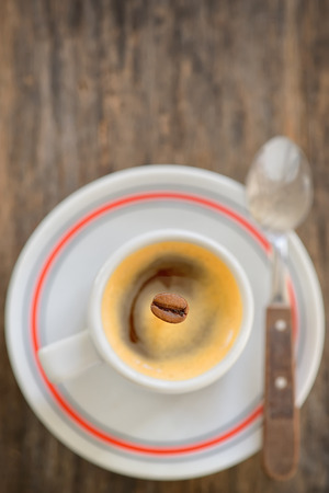espresso cup: Cup of espresso coffee and one bean Stock Photo
