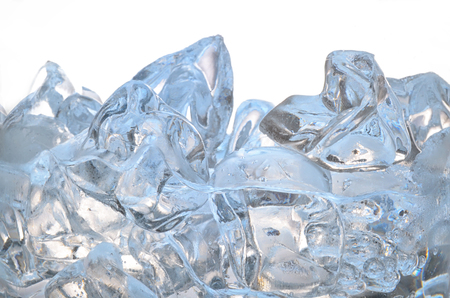 Glass with frozen ice cubes isolated on white