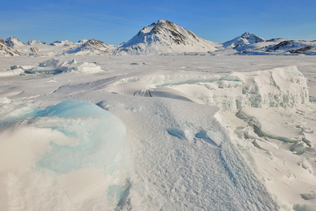 Greenland frozen ice and mountains