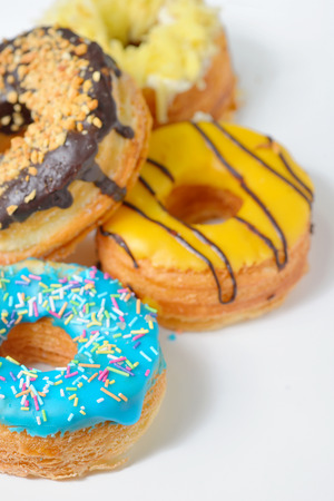 Different Types of Donuts on white table