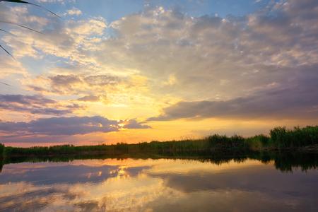 Sunset over danube delta in summer time Stock Photo