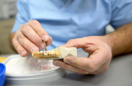 Dental technician working in dental laboratory