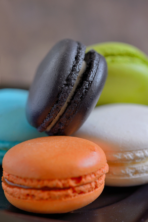 french colorful macarons on wooden table Stock Photo