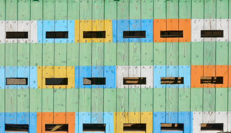 Abstract coloured beehives in spring time