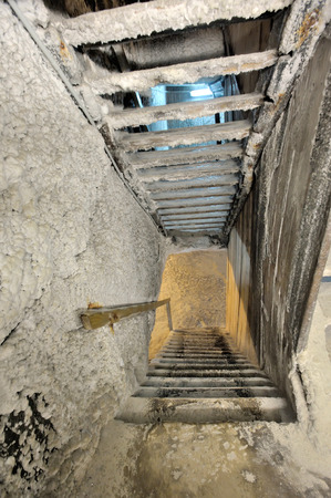 turda: Old salt mine staircase covered with salt