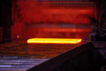 Hot steel plate on conveyor Imagens