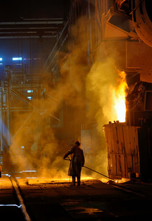 molted: steel worker near oven  inside of steel plant Stock Photo