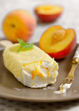 Peach ice cream on plate