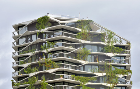 A green residential tower with climber plants -  Bern, Switzerland - 23 july 2017