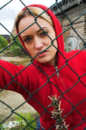 The girl behind the fence