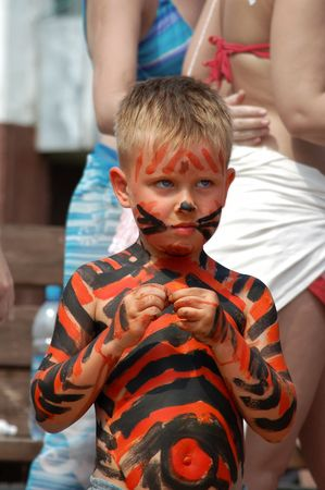 litle boy bodyart tiger on the beach  Stock Photo - 3124483