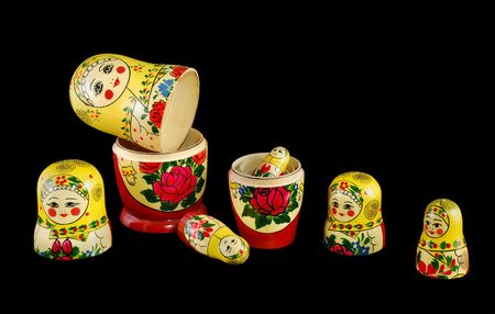 Matreshka_constructor russian dolls separated as constructor on black background photo