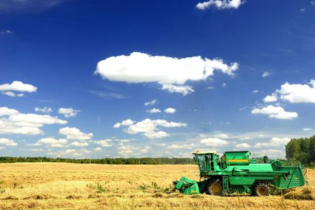 combine harvester working a wheat field