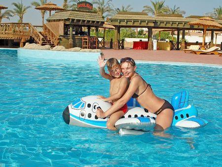 Caucasian family at pool having fun in a pool Stock Photo