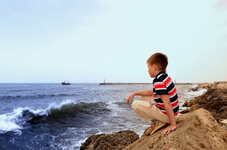 sea, water, looking, sky, coastline, person, beach, summer, one, nature, child, view, horizon, boy, wave, outdoors, clothing, ocean, rock, caucasian, look, blue, scene, watching, serene, pensive, relaxation, cloud, t-shirt