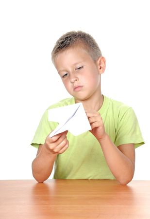 son deposit: boy makes paper plane over white background Stock Photo