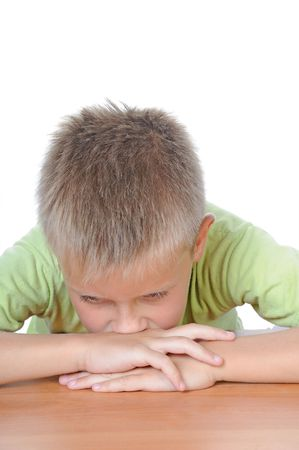 Kid with a thinking expressionportrait of young serious handsome man sitting  Stock Photo - 5387969