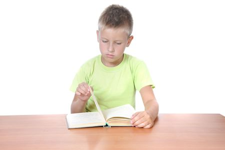 boy with the book behind a table over white background Stock Photo - 5618879