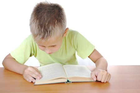 Photo of smart pupil sitting and reading textbook over white background photo