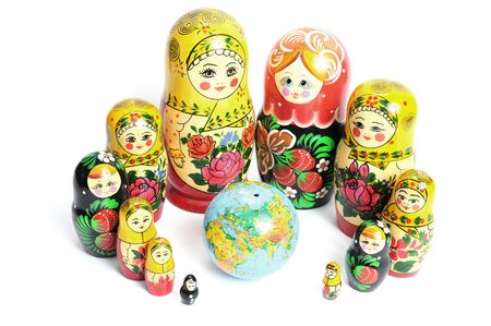 russian doll on the white around the world Stock Photo - 5630972