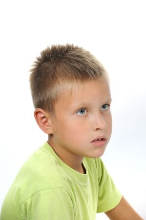 hope indoors luck: Handsome serious boy with blond hair and gray eyes Stock Photo