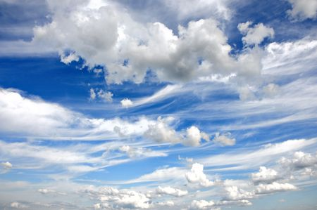 White cumulus clouds and a blue sky  Stock Photo - 5677886