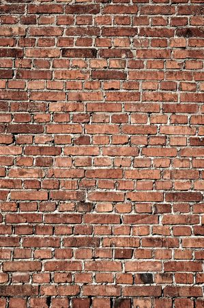 tilable: old weathered stained red brick wall background