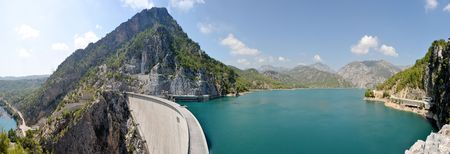 mountain canyon and hydroelectric dam panorama under sky