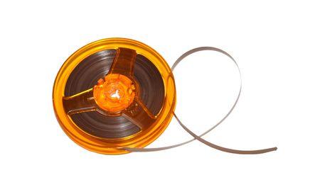 Roller Tape Kassette Spool auf weißem Hintergrund  Standard-Bild
