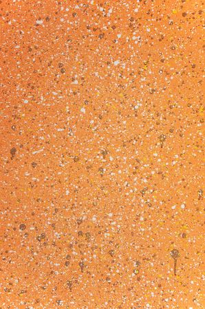 grisly: color splatter on a grungy rock wall abstract background