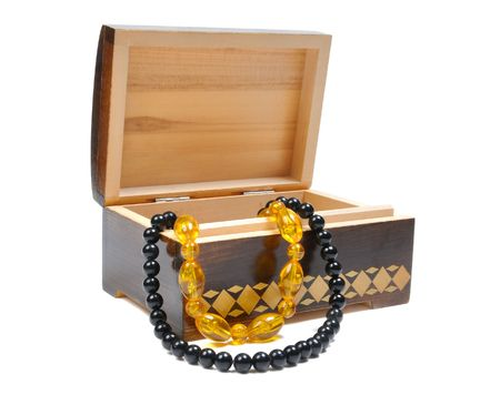 wooden box with jewelry on a white background Stock Photo - 6124853