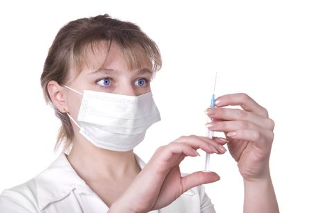 h1n1 vaccinations: Young nurse in mask with syringe, isolated on white background Stock Photo
