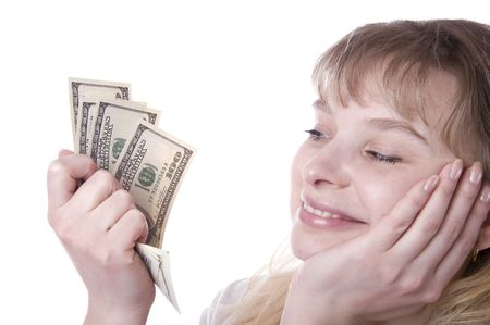 Beautiful young woman holding a stack of money isolated over white photo