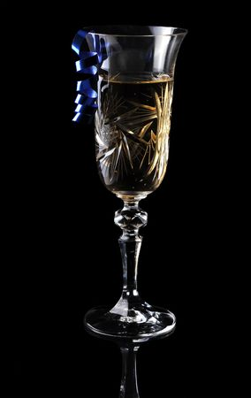 champaign: Glass of xmas champagne on a black background