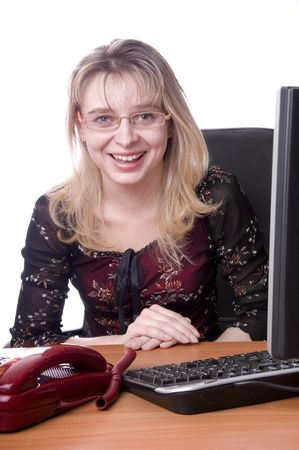 charming secretary sits behind table at office over white Stock Photo - 6752465