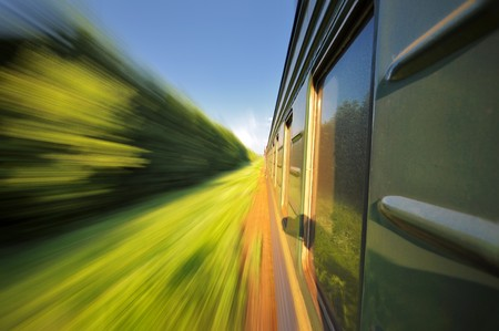 Fast riding a train passenger with motion blur