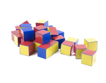 plastic bricks: small heap of color plastic bricks toys on white
