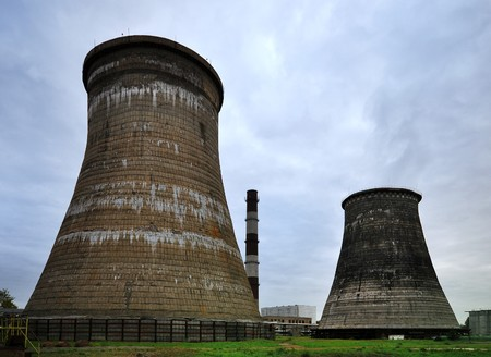 Cooling towers of power station under blue sky photo