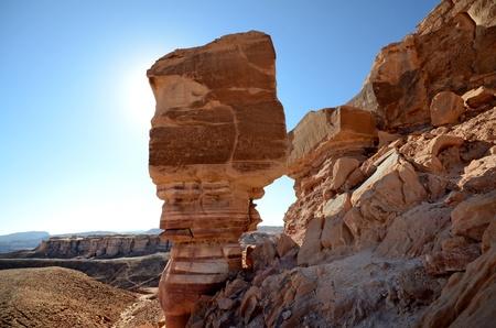 desert landscape under bright blue sky and sun Stock Photo
