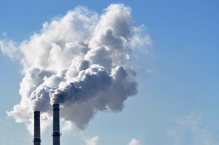 greenhouse gas: industrial smoke from chimney on blue sky