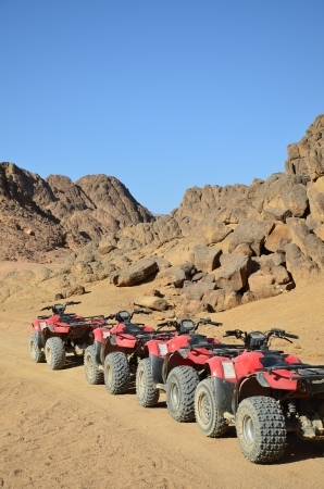 four wheel drive: wheel of desert scooter arranged in a row